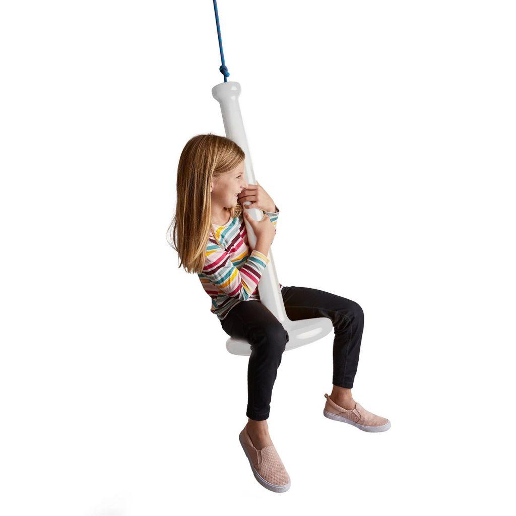 Girl swinging on Tupelo swing